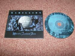 1000 FACES CD SIGNED BY S ROTHERY