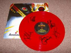 ANIMAL FULLY AUTOGRAPHED RED VINYL 12INCH