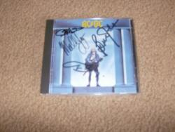 WHO MADE WHO CD SIGNED